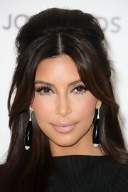 Kim Kardashian finished off her look with a pair of black and silver dangle earrings.