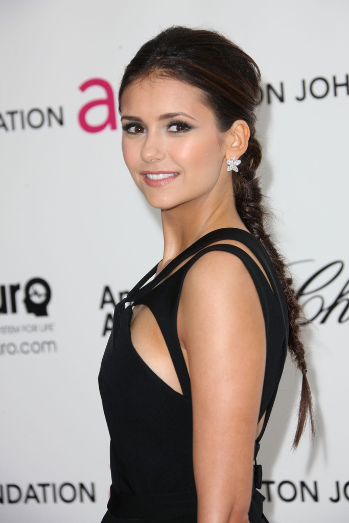 Actress Nina Dobrev arrives at the 20th Annual Elton John AIDS Foundation's Oscar Viewing Party held at West Hollywood Park on February 26, 2012 in West Hollywood, California.