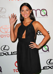 Olivia Munn wore several layered bracelets to accent this little black dress.