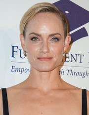 Amber Valletta wore a masculine-chic partially shaved hairstyle to the Fulfillment Fund Stars Benefit Gala.