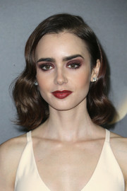 Lily Collins' amped up the fierceness with a red lip.