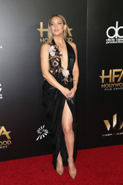 Kate Hudson exposed her cleavage and legs in a flower-adorned halter gown by Marchesa during the Hollywood Film Awards.