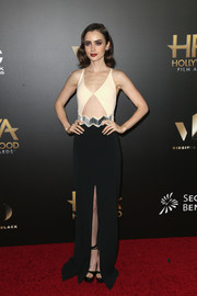 Lily Collins worked an Art Deco-inspired black-and-white cutout gown by David Koma at the Hollywood Film Awards.