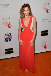 Alyson Michalka took the plunge with this red and nude gown that featured a plunging V-neck.