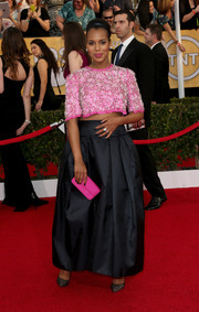 Kerry Washington teamed her crop-top with a long black Prada skirt for a more glamorous finish.