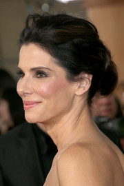 Sandra Bullock swept her hair back into an elegant loose bun for the SAG Awards.
