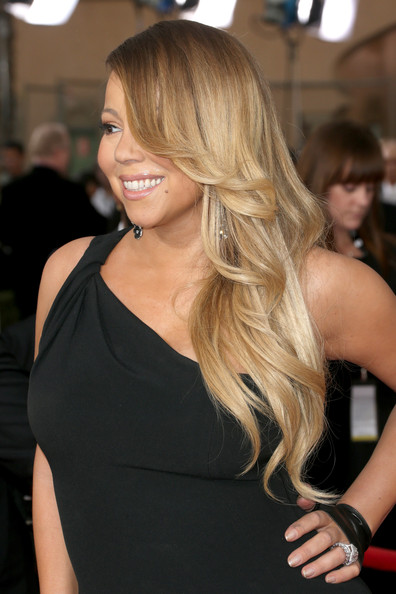 Mariah Carey attended the SAG Awards wearing her long hair in a feathered flip.