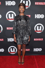Issa Rae attended the Urbanworld Film Festival screening of 'Insecure' wearing a tiered gunmetal cocktail dress.