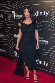Kim Kardashian highlighted her voluptuous figure in a ruched, asymmetrical LBD by Vivienne Westwood at the Webby Awards.