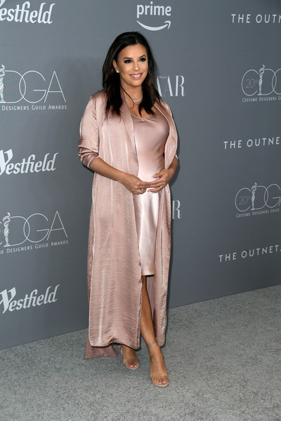 Eva Longoria finished off her ensemble with trendy PVC sandals by Marskinryyppy.