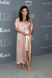 Eva Longoria layered a dusty-pink satin duster by Juan Carlos Obando over a matching Nili Lotan slip dress for the Costume Designers Guild Awards.