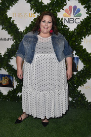 Chrissy Metz layered a denim jacket over her dress for a more relaxed finish.