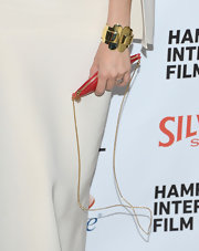 Sienna Miller's gold bangle was an eye-catching architectural addition to her sophisticated style.