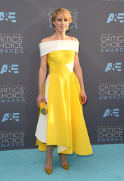 Carrie Coon wore an off-the-shoulder yellow and white gown with an uneven hem at the Critics Choice Awards that she styled with Maryam Shahbazi  earrings.