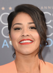 Gina Rodriguez glammed it up with this loose bun at the Critics' Choice Awards.