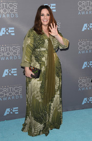 Melissa McCarthy chose a forest-green feather-print gown from her own line for her Critics' Choice Awards look that she wore with jewelry from Anne Sisteron.