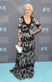 Helen Mirren styled her gown with a white fur clutch.