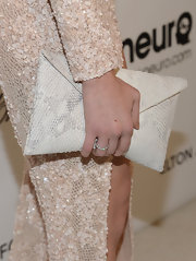 Analeigh Tipton attended Elton John's Oscar bash carrying a totally edgy and cool white python envelope clutch.