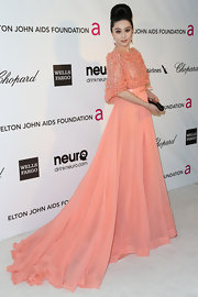 Fan Bingbing looked elegant and sophisticated at Elton John's Oscar party with a pink flowing gown with matching shawl-cape.