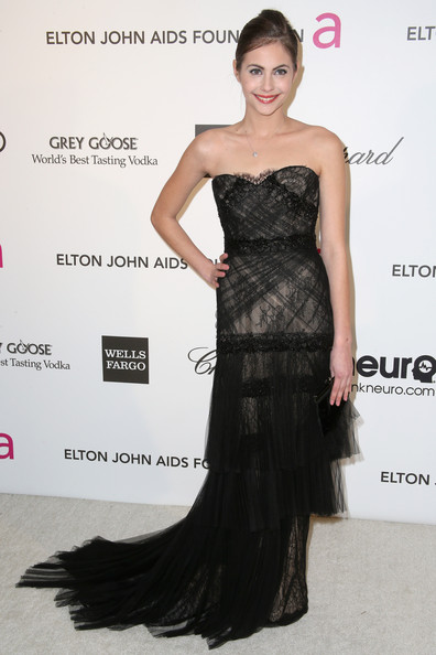 A black strapless dress with layered lace tulle completed Willa Holland's Oscar-party look.