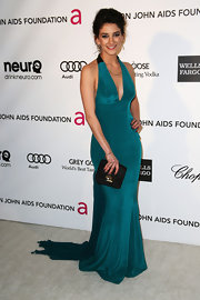 Sheila Vand chose a pop of color with this teal halter dress.