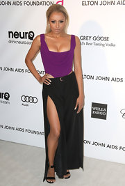 Kat Graham showed off her funky, edgy style with a purple and black dress with cutouts and a front slit.