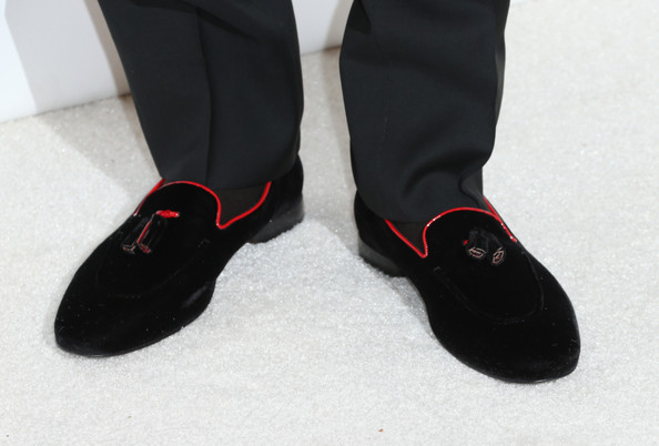 Chris Brown wore a pair of sleek black loafers with tassels and red piping as he attended Elton John's party.