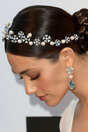 Emmy Rossum topped off her elegant evening look with a aquamarine, pearl and diamond headpiece set in white gold.