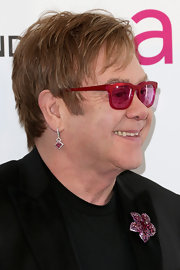 Elton John has never been one to shy away from jewels like these pink drop earrings, which he wore to his Oscar-viewing party.