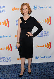 Cynthia showed she's serious both about style and gay rights in a chic, one-shoulder LBD.