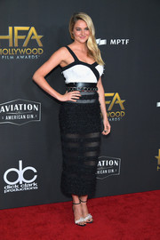 Shailene Woodley teamed her bodysuit with a sheer-striped pencil skirt, also by Balmain.