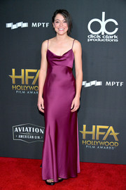 Tatiana Maslany made an alluring choice with this magenta satin slip gown by Diane von Furstenberg for the Hollywood Film Awards.