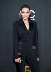 Elizabeth Olsen styled her pantsuit with a black velvet clutch when she attended the Hollywood Film Awards.