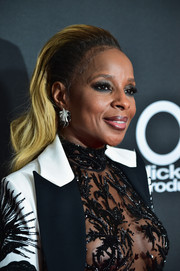 Mary J. Blige sported a slicked-back wavy hairstyle at the Hollywood Film Awards.