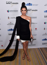 Diane Guerrero attended the NHMC Impact Awards Gala wearing a one-sleeve black-and-white dress with a watteau train.