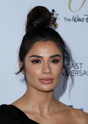Diane Guerrero worked a loose top knot at the NHMC Impact Awards Gala.
