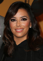 Eva Longoria styled her hair with bouncy waves for the SAG nominations event.