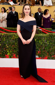 Emilia Clarke kept her SAG Awards look minimal (with a bit of edge) in a Donna Karan Atelier off-the-shoulder column dress in black with navy crisscross detailing.