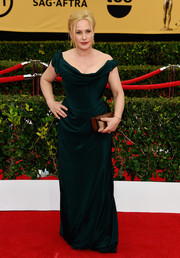 Patricia Arquette made a regal entrance at the SAG Awards in a Vivienne Westwood signature: draped, corseted, and off off-the-shoulder in an elegant dark green hue.