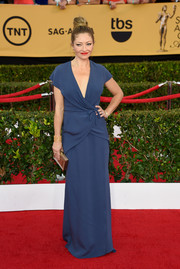 Rebecca Gayheart chose a classic wrap gown in a muted blue shade for her SAG Awards red carpet look.