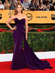 Camila Alves was a stunning presence on the SAG Awards red carpet in a Donna Karan Atelier strapless gown in rich purple with a dramatic side train.