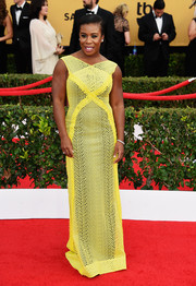 Uzo Aduba exuded modern glamour at the SAG Awards in a vivid yellow mesh gown by Angel Sanchez.