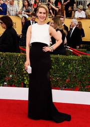 Sarah Paulson went for minimalist elegance in a Giorgio Armani gown, featuring a cropped white bodice overlay and a floor-sweeping black skirt, at the SAG Awards.