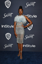 Kiki Layne complemented her frock with a pair of strappy silver heels by Rene Caovilla.