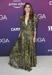 Marisa Tomei opted for a green print gown with a plunging neckline and mutton sleeves when she attended the 2019 Costume Designers Guild Awards.