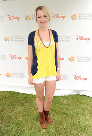 Bridgit Mendler layered a short-sleeved navy cardigan over a yellow tank for an easy, breezy summer feel.