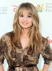 Debby Ryan highlighted her bronzed glow and honey-hued locks with a subtle swipe of shimmering lip gloss.