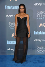 Naomie Harris paraded her toned arms and legs in a strapless, sheer-bottom gown at the Critics' Choice Awards.