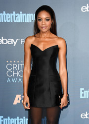 Naomie Harris matched a polka-dot box clutch with a strapless gown for her Critics' Choice Awards look.