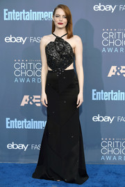 Emma Stone was equal parts sexy, edgy, and glam at the Critics' Choice Awards in a black Roland Mouret halter gown with an embellished bodice and waist cutouts.